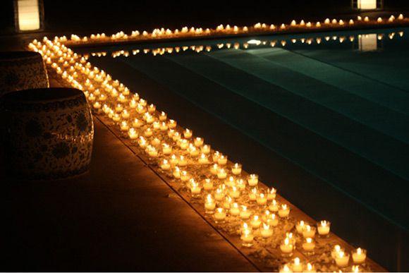 floating candles around pool | Pool theme | Pinterest | Pool wedding ...