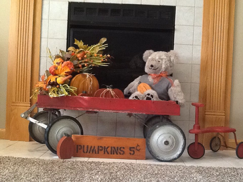 Fall is in the air!  Antique red wagon filled with wooden pumpkins.