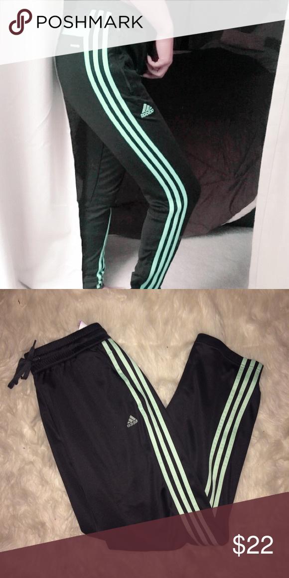 3f17ee0ece7a Adidas Mint Track Pants Adidas track athletic pants. Size medium. NWOT.  Black with mint green stripe. Light weight   strait leg. Elastic band  around waist ...