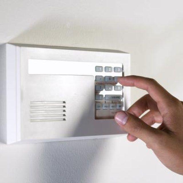 How To Reset A Stanley Garage Door Keypad Hunker Garage Door Keypad Garage Doors Garage Door Parts
