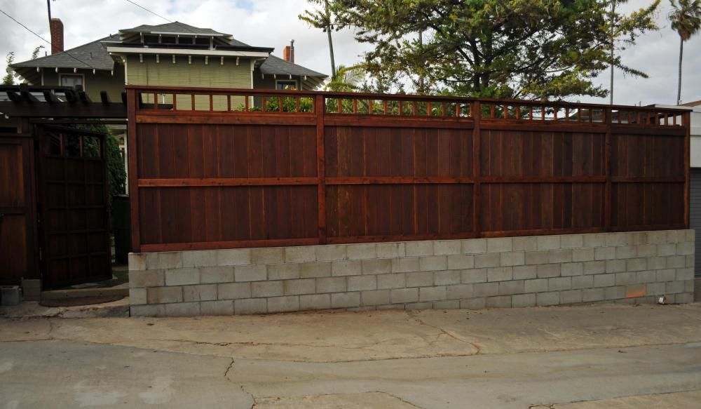 Simple Cinderblock Base To Keep Wooden Fence From Getting Wrecked - Cinder block wall fence ideas