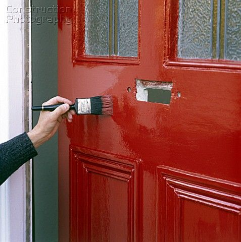A085 00076: Painting A Front Door With Bright Red Paint. Description From  Constructionphotography