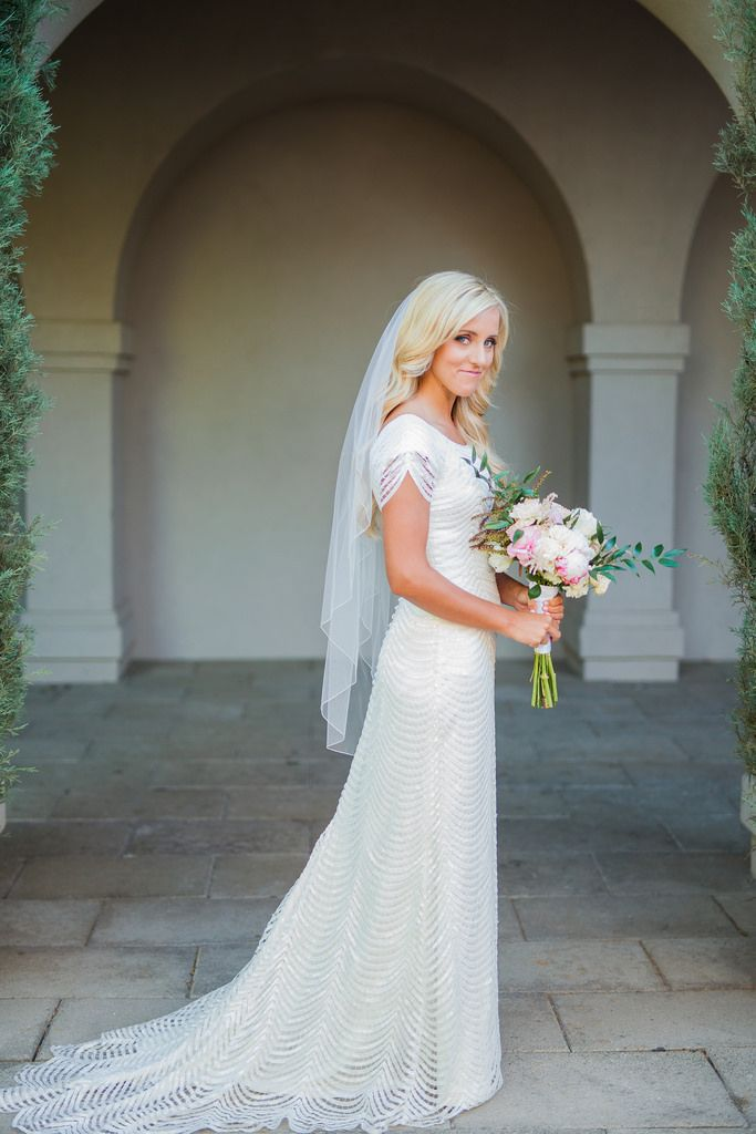modest wedding dress with half sleeves and a flowing skirt from alta ...