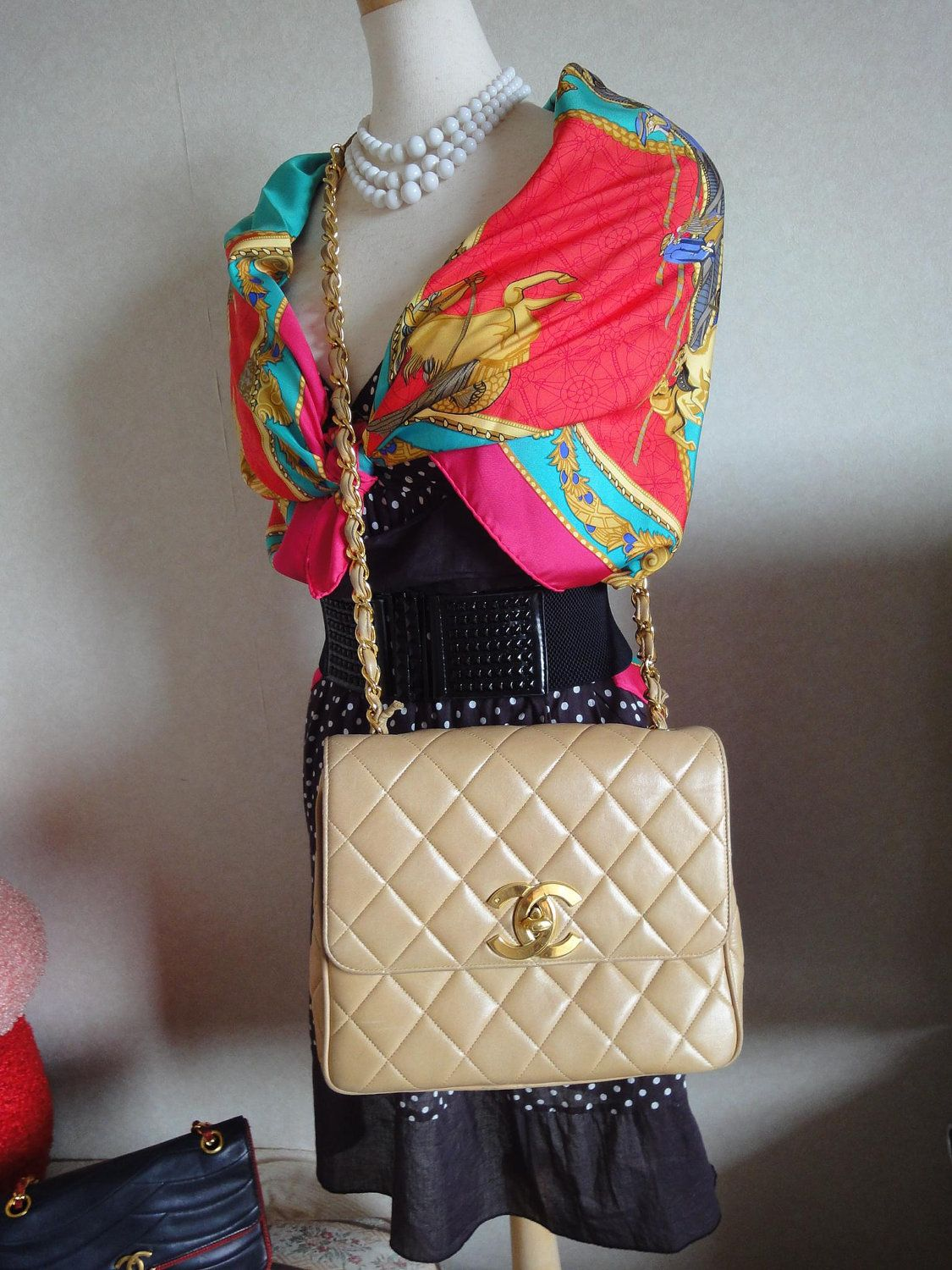 Vintage CHANEL Beige quilted lambskin purse with the big CC and gold-tone chain handle