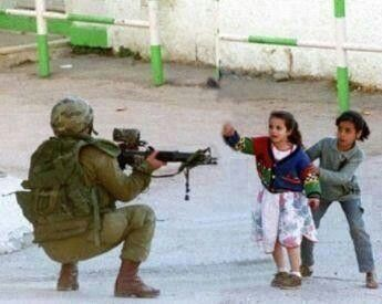 """Palestinian Arab Muslim Girl Protecting Other from Israeli Soldier (Photograph; Israel/Filisthiin, `Shaam) #Palestine #Secular #Terrorist _________________________________ ❝& what is [the matter] with you that you fight not in the cause of Allah & [for] the oppressed among men, women, & children who say, """"Our Lord, take us out of this city of oppressive people & appoint for us from Yourself a protector & appoint for us from Yourself a helper?❞ -Allah ﷻ (Translation Qur'aan 4:75) #Quote…"""
