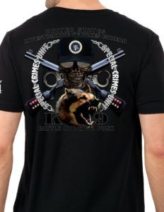US Investigative Services Bureau Shirt is a subdued LEO design that illustrates the strength and determination of fighting criminals and lawlessness in teams of two with K-9s.