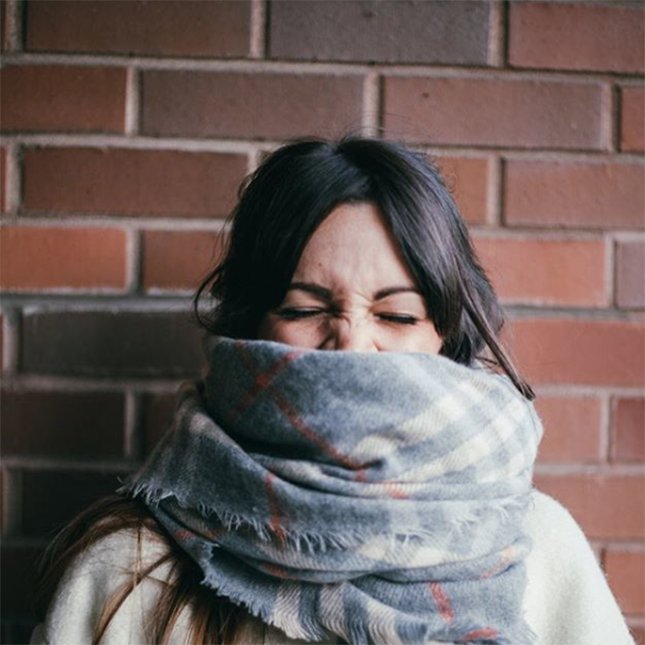 Wrap your scarf around your lush locks and let the rest of your hair peek through at the ends for a casual, messy look.