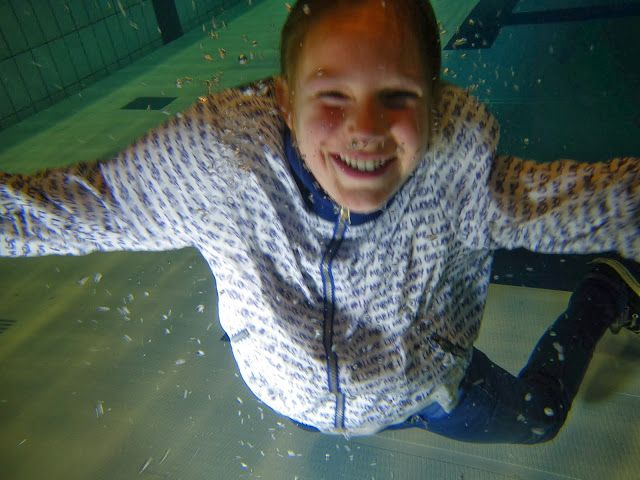 Girl underwater with winter clothes