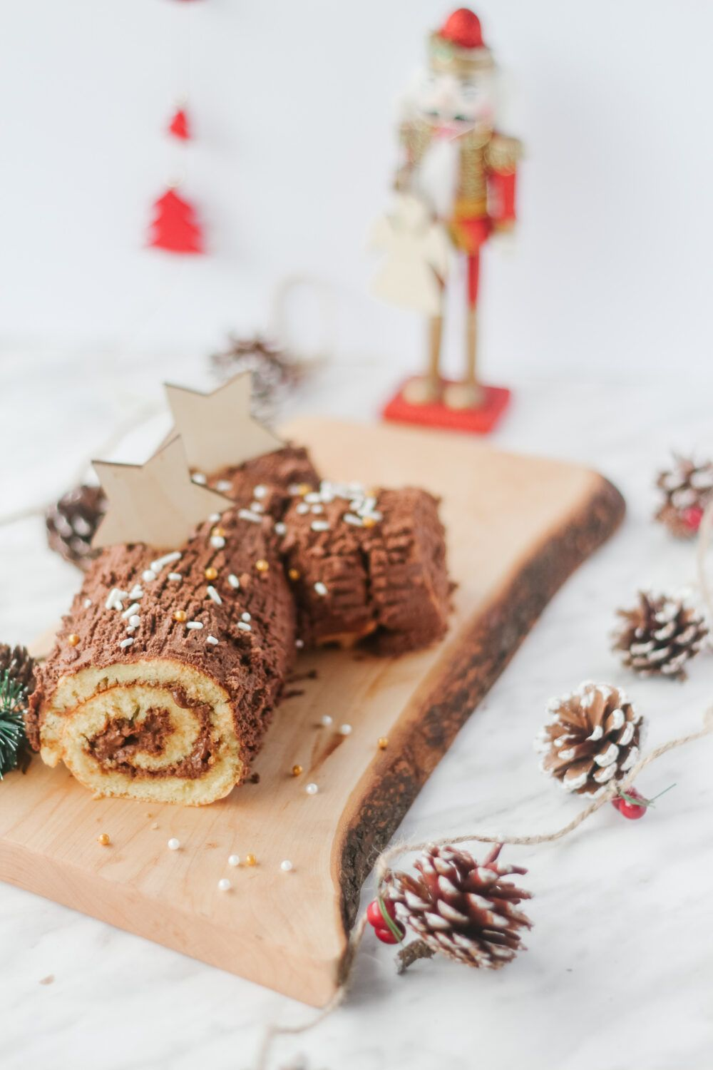 Delicious chocolate yule log is easy to prepare & will be a hit at the Christmas table. Step-by-step recipe of the roulé cake and the chocolate ganache. #yulelogrecipe
