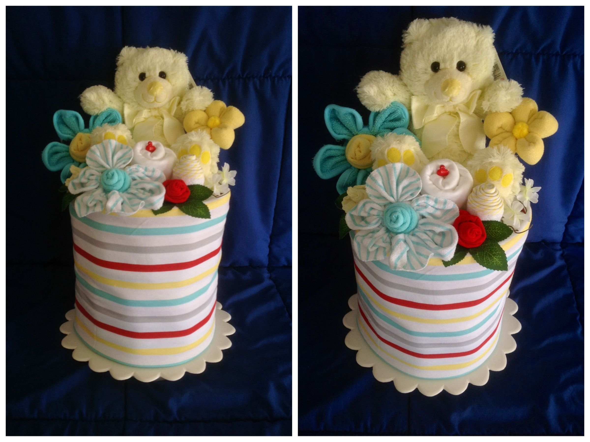 Nappy cake baby gifts wrapped in cotton baby blanket chock a baby gifts wrapped in cotton baby blanket chock a block full of disposable nappiesdiapers topped with baby onesies sox bibs mittens hat singlet negle Image collections