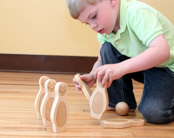 natural wooden bowling game - 6 pin organic wood skittles, a classic toy set, earth-friendly penguin bowling for toddler and preschooler. $29.00, via Etsy.