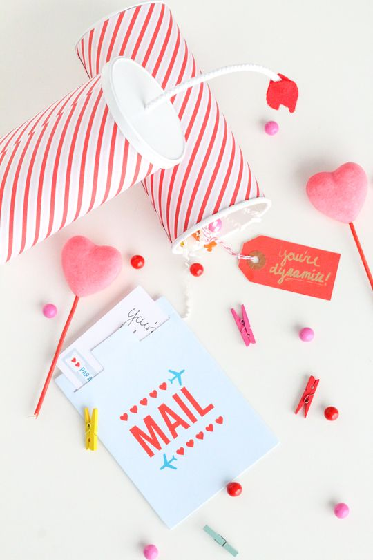 DIY You're Dynamite Valentines | Wrap tube shaped containers with card stock and fill with goodies. Be sure to add string at the end of the tube, to simulate a stick of dynamite.