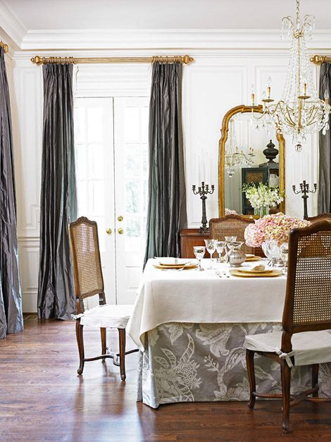 Floor To Ceiling Gray Silk Draperies Add Drama And Warmth This All White Dining Room The Patterned Table Skirt Also Adds A Splash Of Glamour