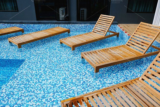 Wooden Bench On Swimming Pool