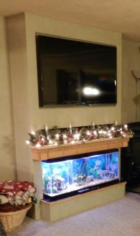 Built in tv fish tank mantel is hinged to lift up to do tank maintenance just above mantel is - Fish tank dining room table ...