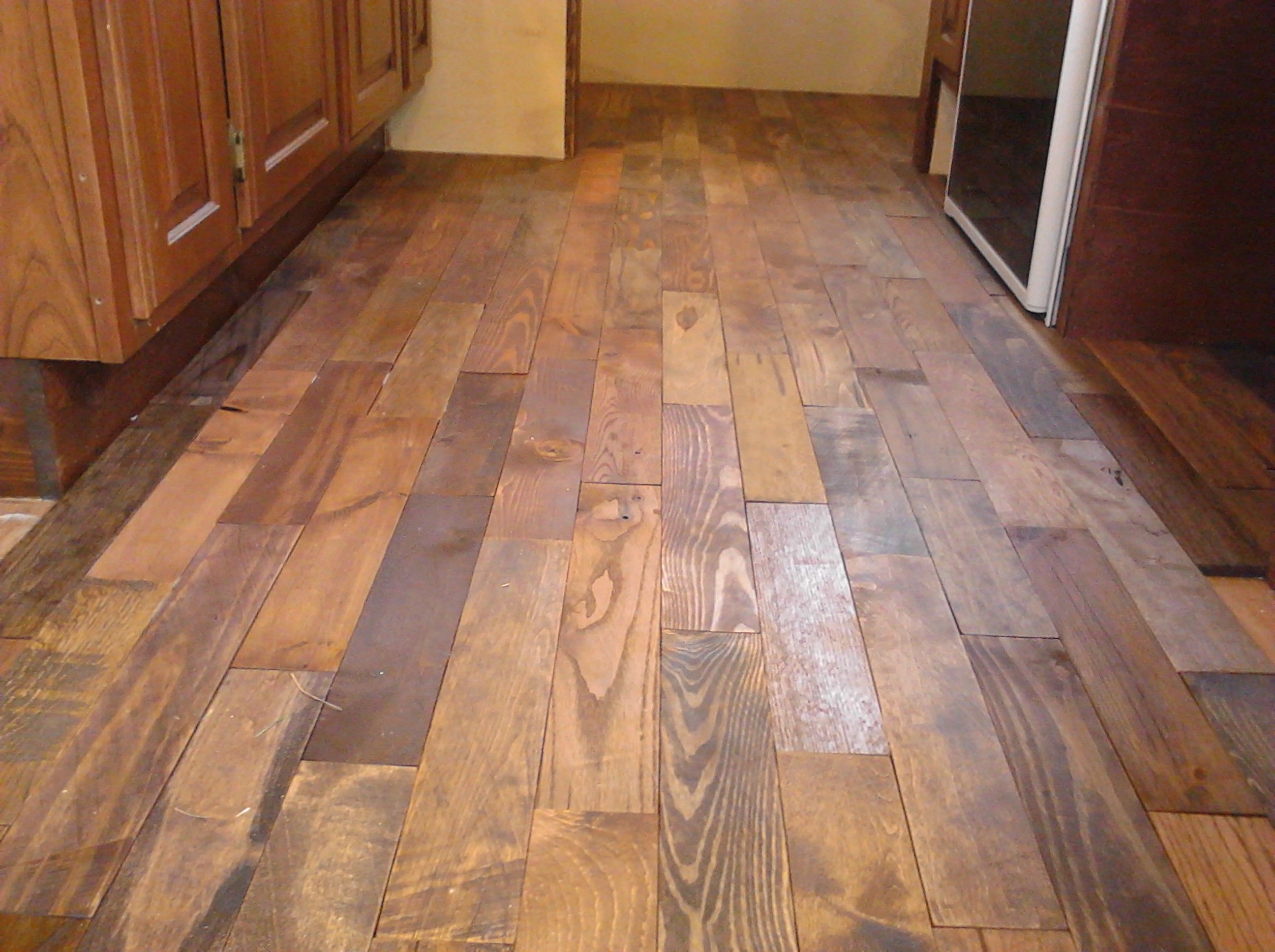 Stained plywood floor kitchen section stained but ideas for Homemade flooring ideas
