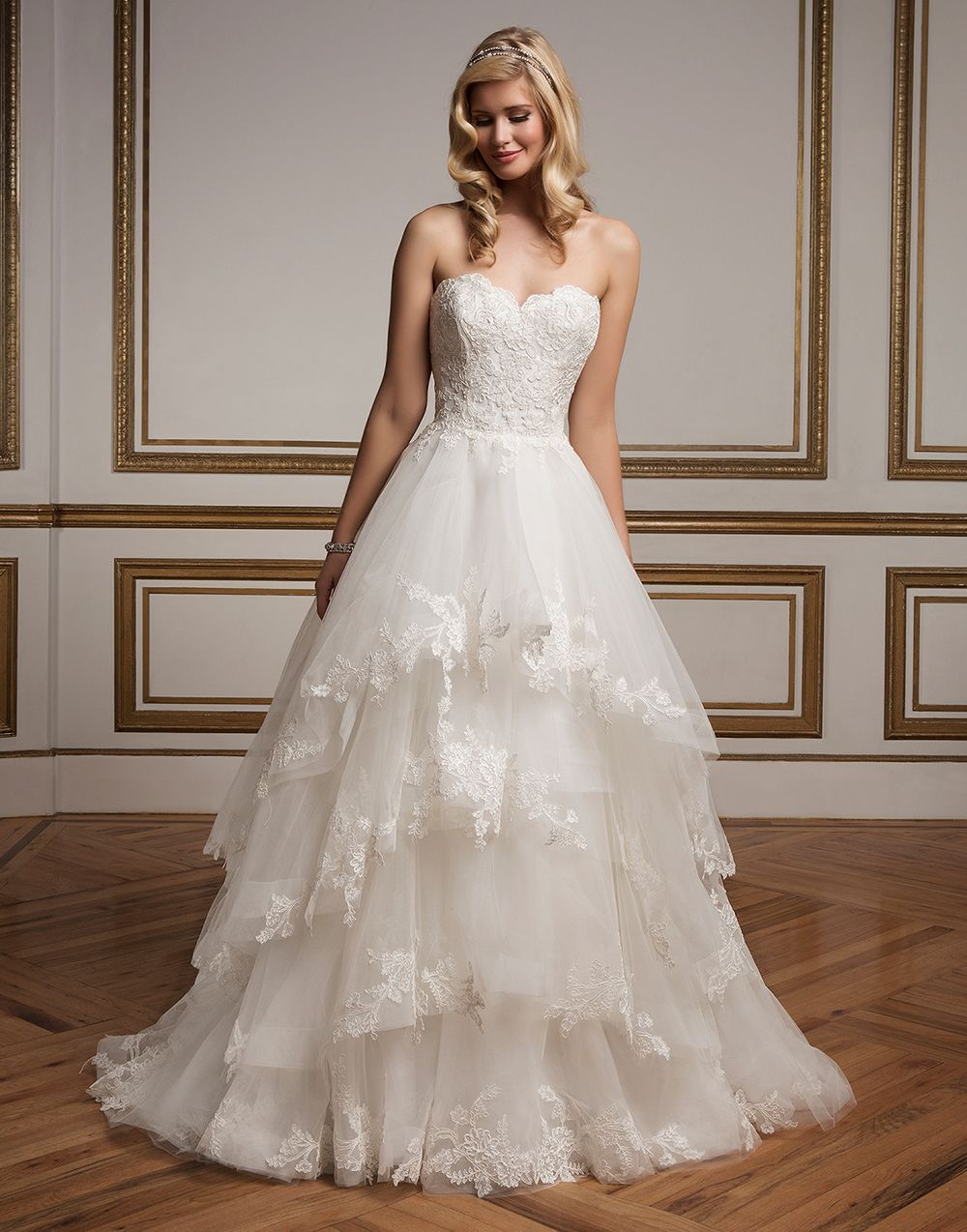 A sophisticated tulle tiered ball gown with sweetheart Alencon lace bodice. The full tulle skirt is accented with lace appliques and is finished with a chapel length train. https://www.justinalexanderbridal.com/wedding_dresses/8823