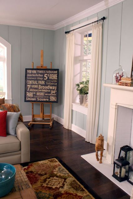 Use An Art Easel To Display Art Beach Themed Living Room Design