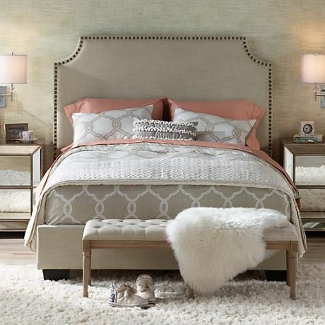 Hand-crafted touches of elegant detail such as hand-nailed trim and natural-tone fabric-wrapped flange accents give this upholstered queen bed its top-to-bottom sophisticated beauty.
