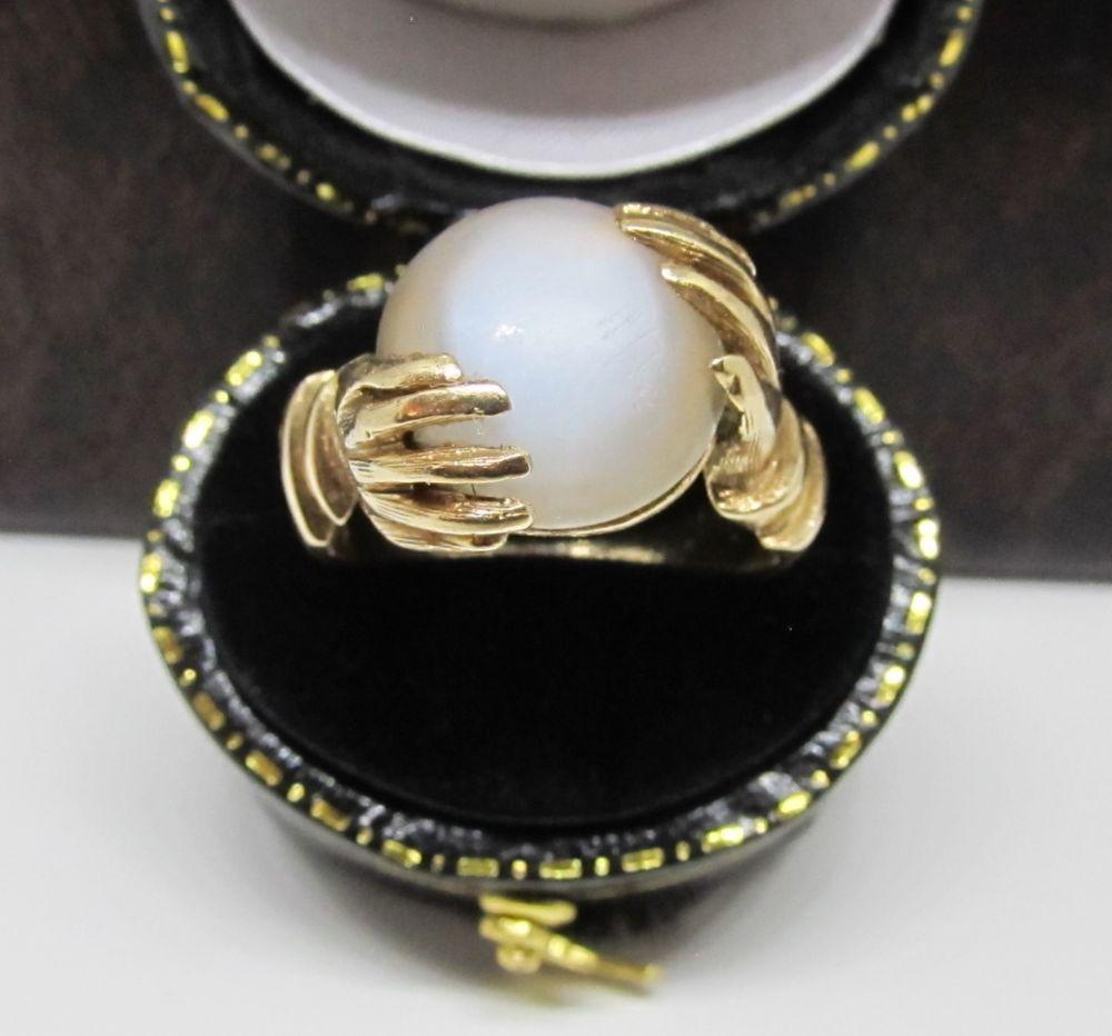 Vintage Fortune Teller Hands Holding Moonstone Crystal Ball
