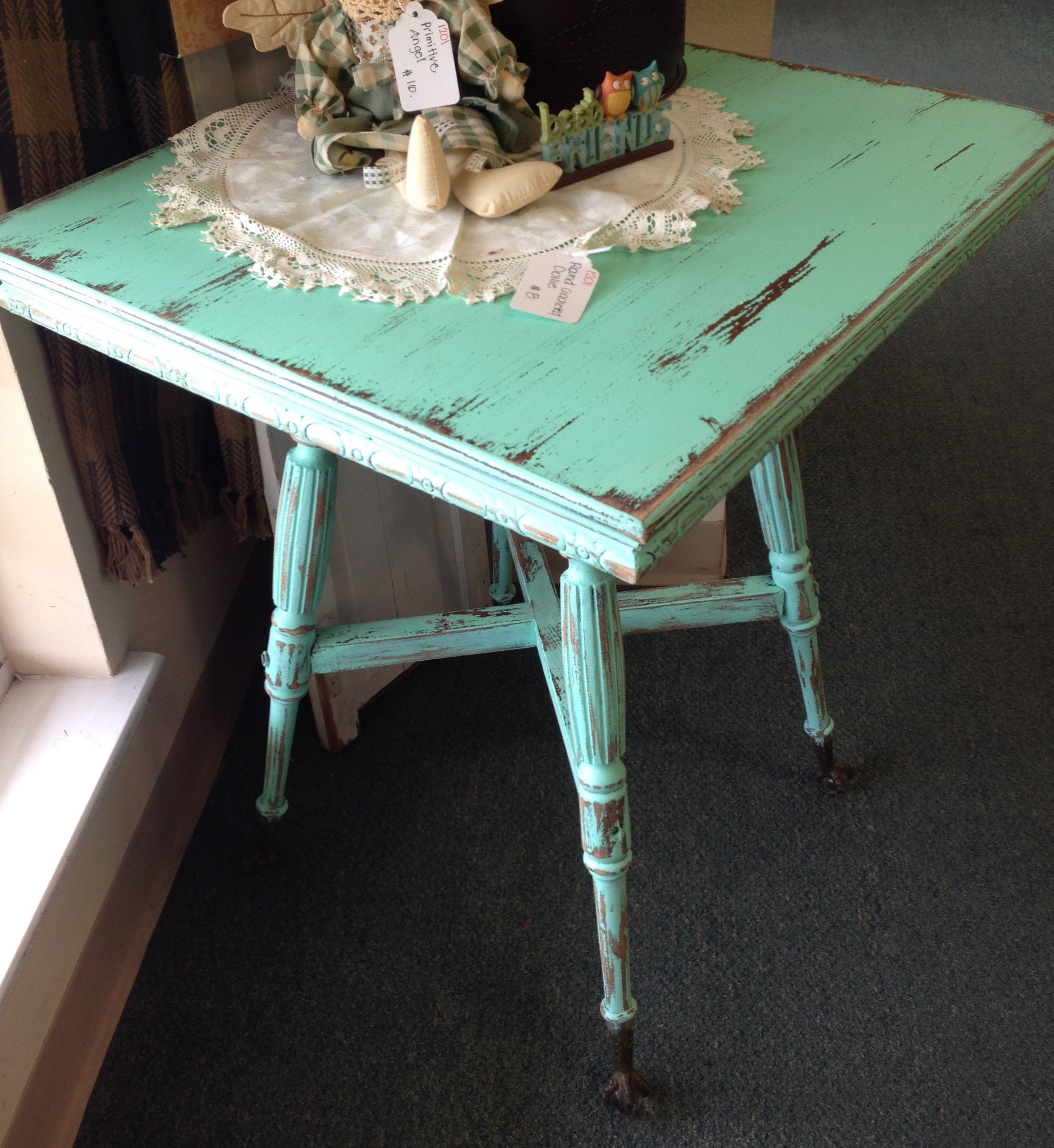 Hand-painted minty green ball & claw foot table at Homestead Handcrafts, San Antonio, Texas.