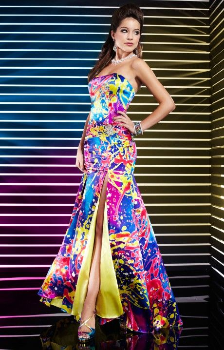 Multi print patterns are the way to go! Studio 17 12291 has a sassy vibrant multi pattern paint splattered inspired filled with bright turquoise, fuchsia, yellows and reds.  A fitted bodice with a slim mermaid skirt supports the strapless sweetheart neckline. The skirt is detailed with a high side slit that reveals the yellow undertones of the skirt. Studio 17 12291 is a fabulous prom dress that will display your sassy personality and your amazing figure!