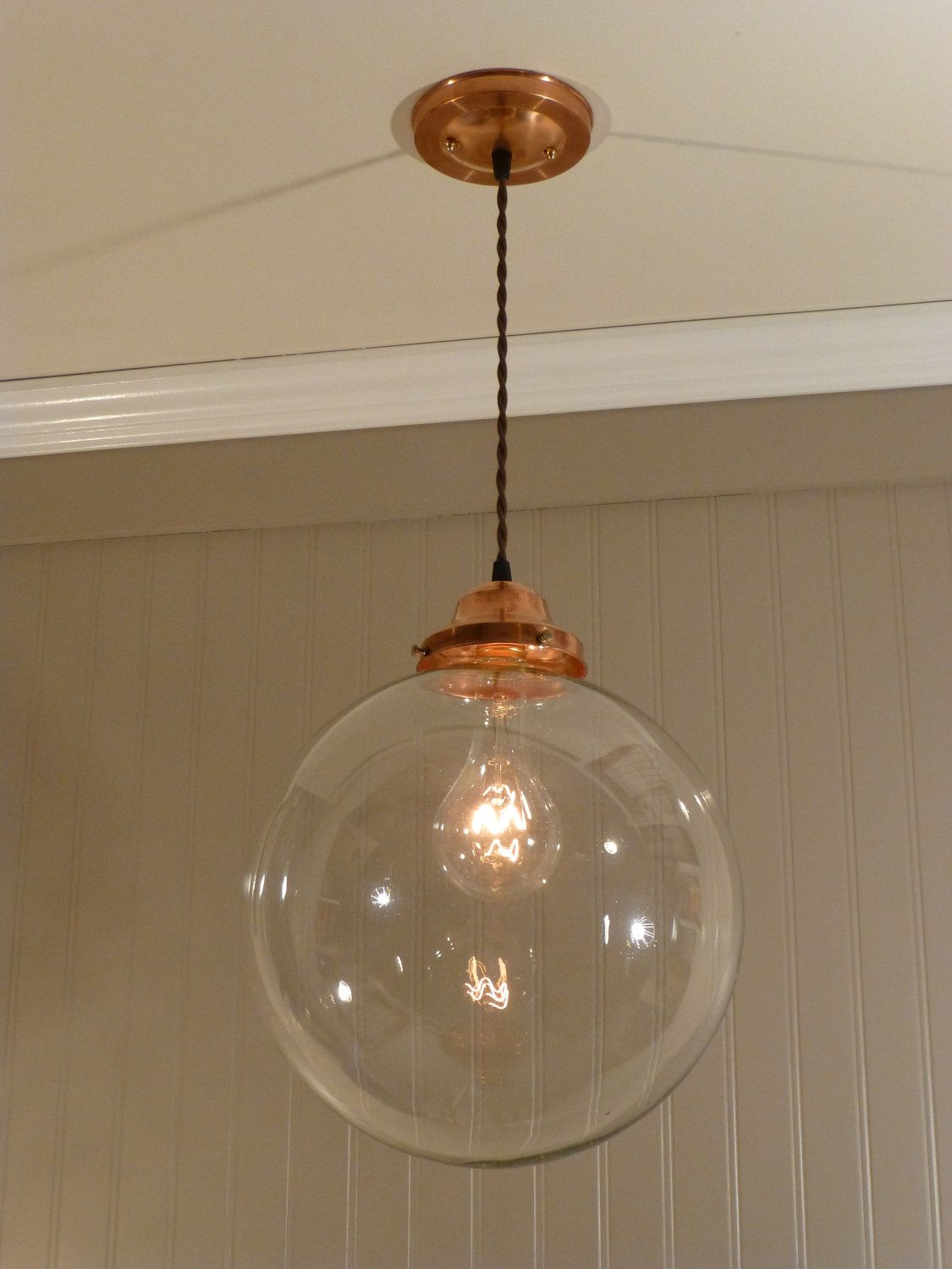 Copper pendant light with a 12 inch clear glass globe 128 00 via etsy