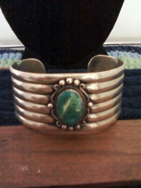 Sterling silver and turquoise cuff bracelet. Bracelet is over 75 years old.  Asking $150.00