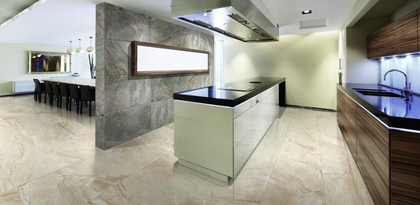 Ivoy coloured Porcelain tiles from our Must series are a welcome contrast  to the dark kitchen. Ivoy coloured Porcelain tiles from our Must series are a welcome