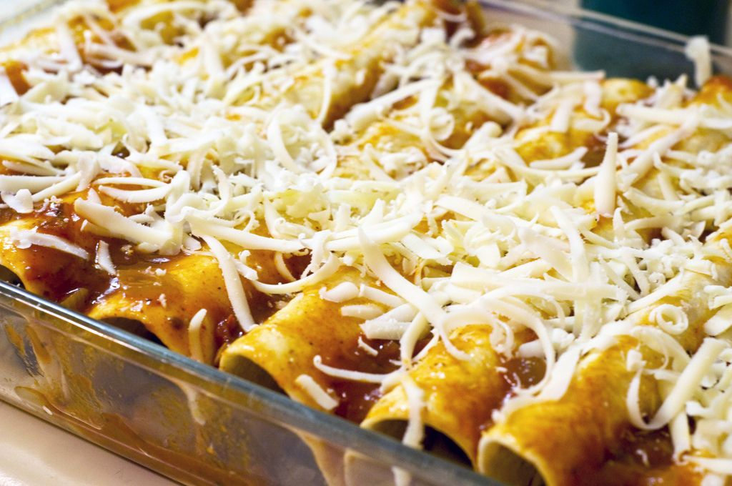 Super Veggie Vegan Enchiladas. Unlike average enchiladas, these are very low in fat and cholesterol and the veggies are a great source of vitamins and energy. You also feel just as full after eating two or three as you would eating the heartier meaty ones. (Daiya soy cheese= my favorite non-dairy melting cheese for stuff like this. Could use dairy cheese on top, if you wanted to, but no longer vegan)