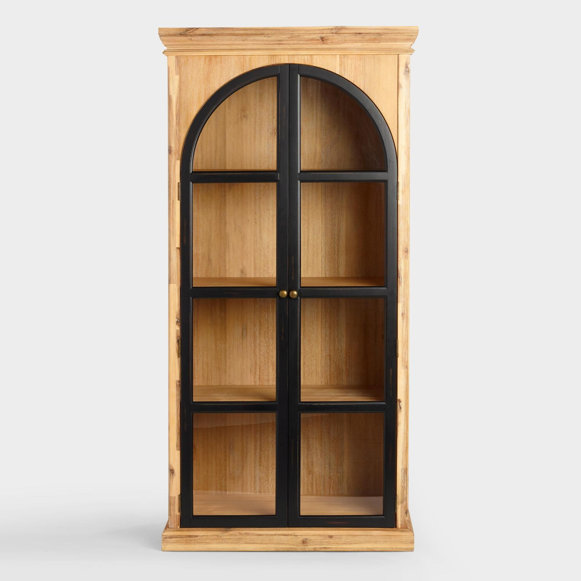 Accented with top and bottom crown molding our curio cabinet takes