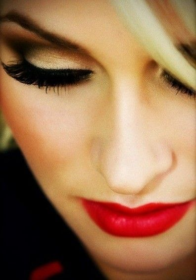 makeup. red lips, brown gold eyes