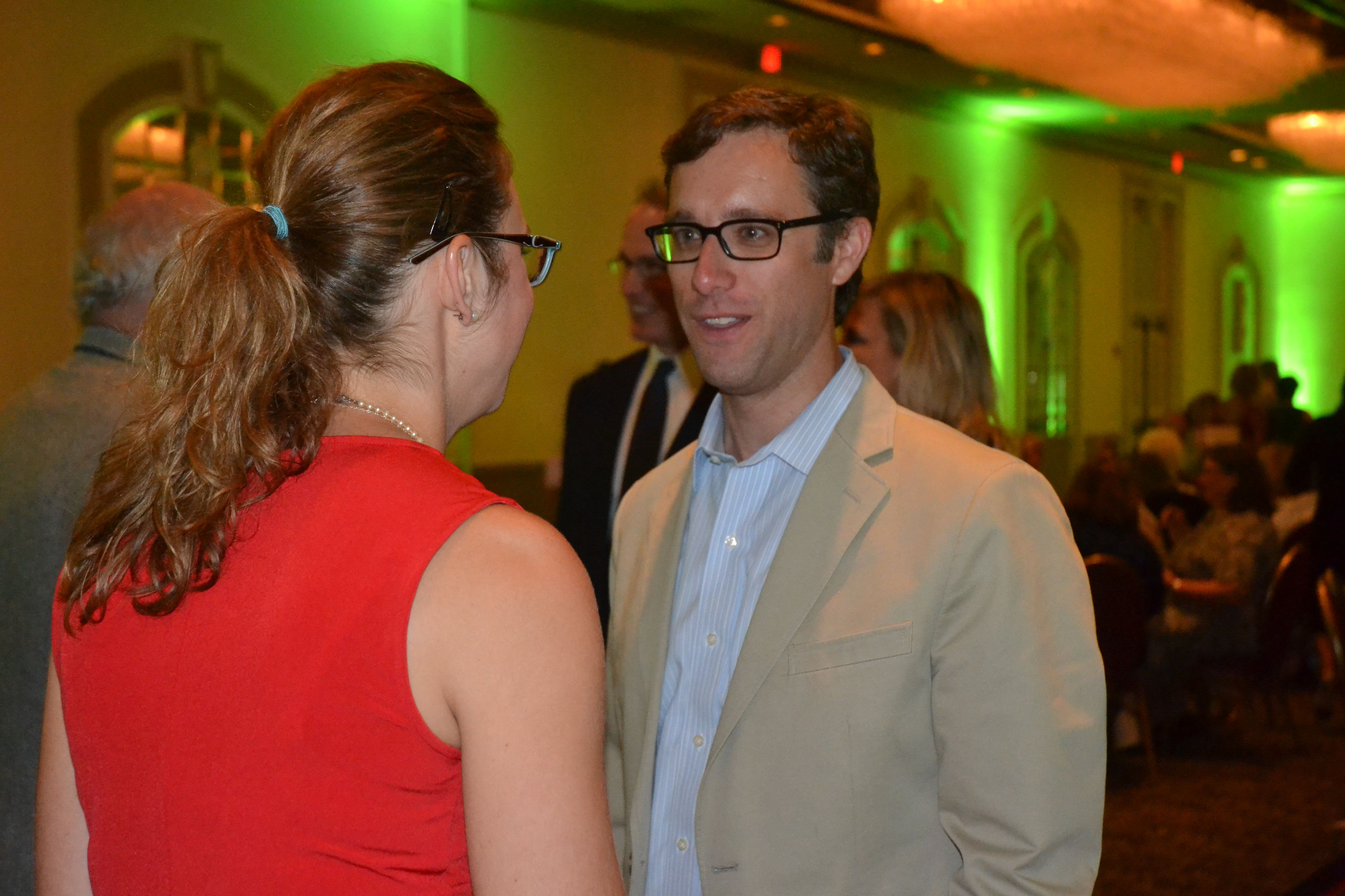 Brian Paschal, executive director of Tulsa's Young Professionals and The Forge, mingles with a guest at the 2013 Women of Distinction Awards dinner