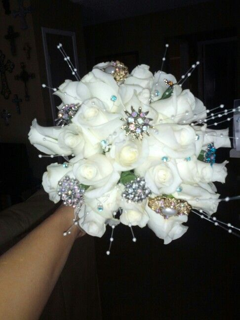 Prom Bouquet these are white roses with rings attached ...