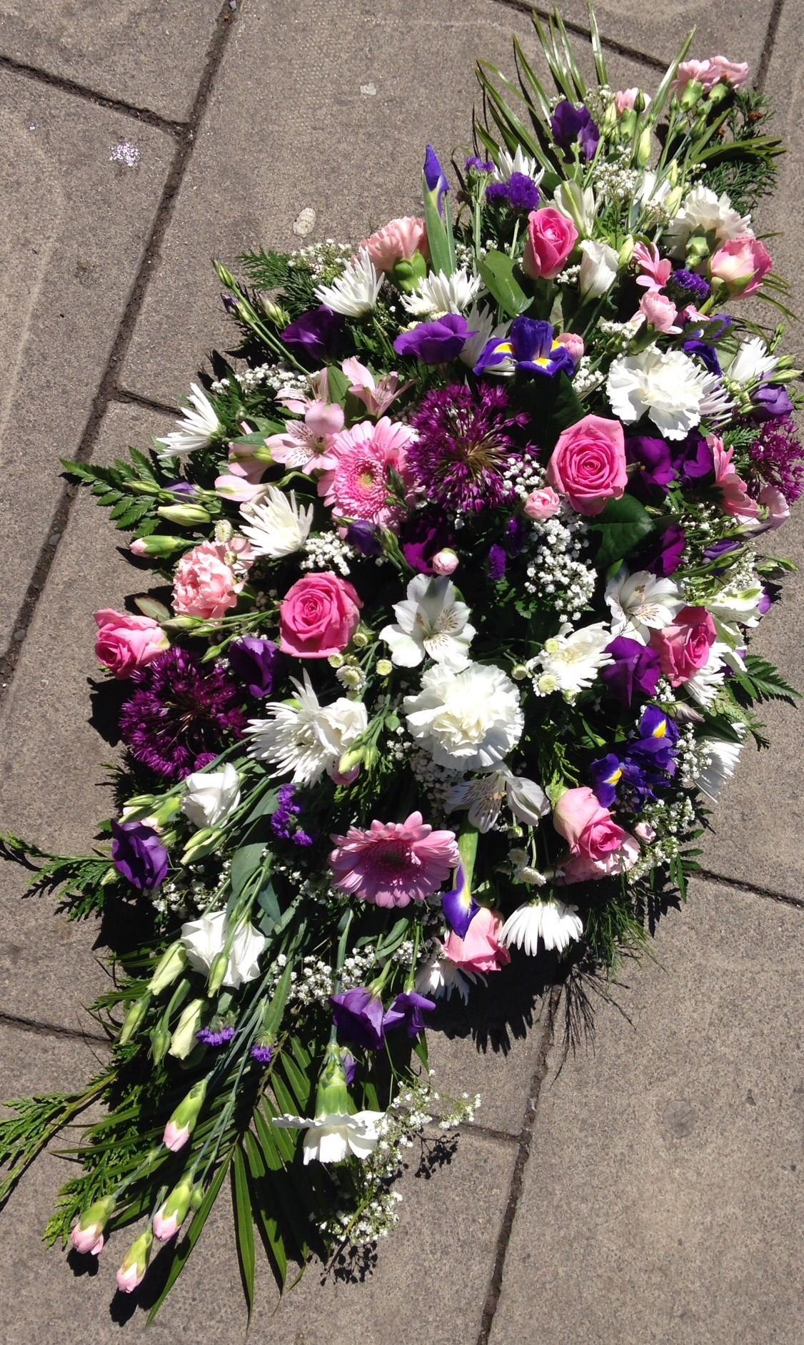 Casket spray pinks white and purples funeral tribute butterflies casket spray pinks white and purples funeral tribute butterflies and blooms uk izmirmasajfo Gallery