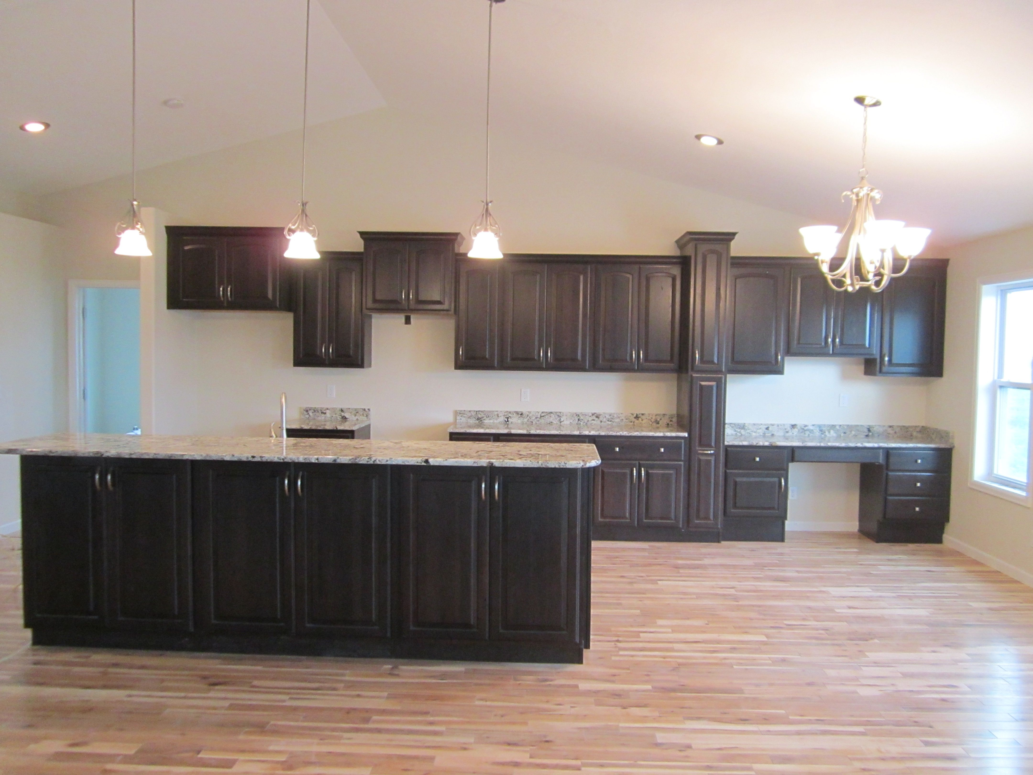 Karman Brand Rustic Hickory Cabinets Harvest Door Style With Java Stain Alaska White G Kitchen Colour Schemes White Granite Countertops Kitchen Remodel