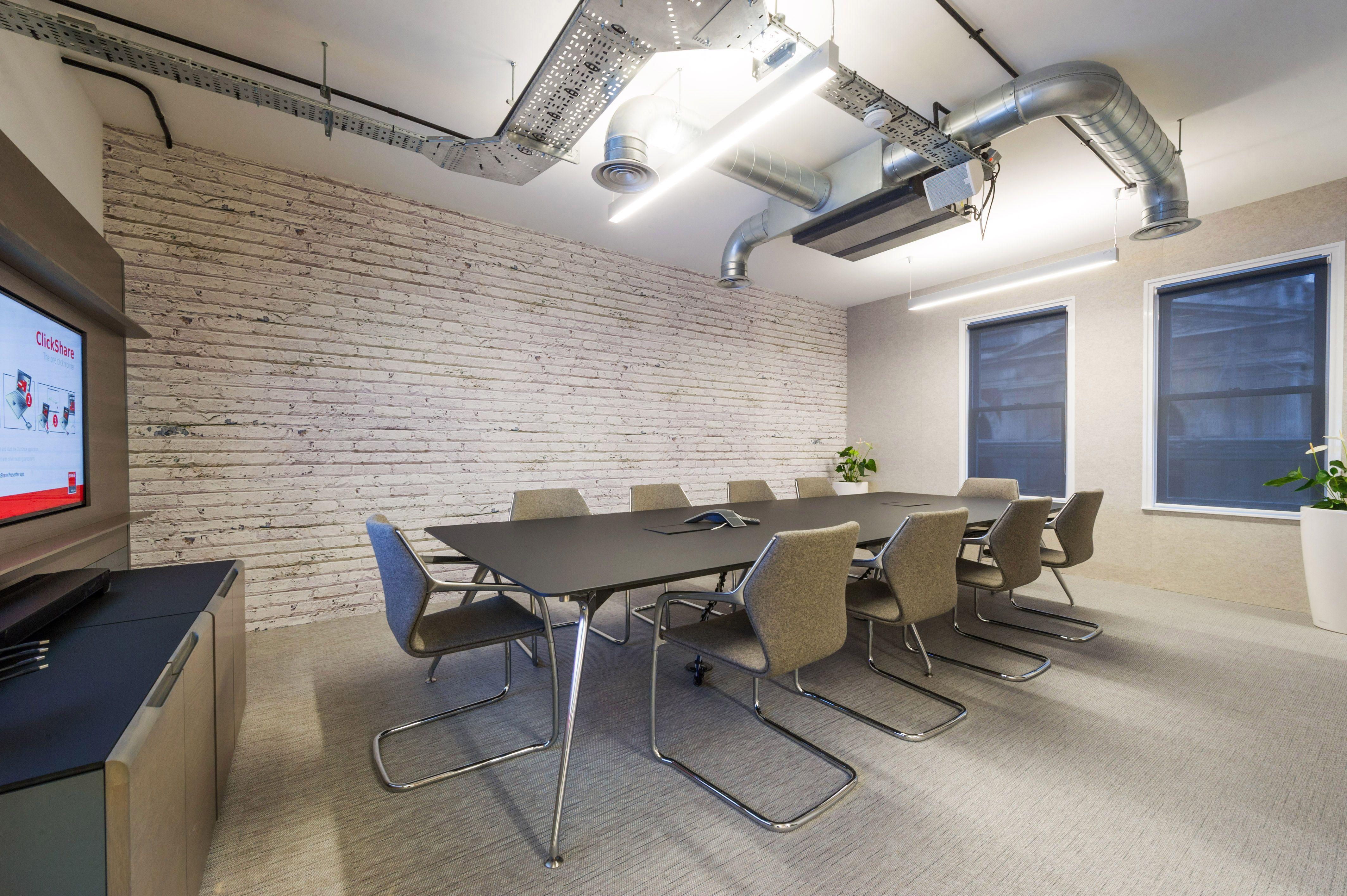 Omega meeting table in solid Fenix and Media wall in Oak veneer and Fenix - on…