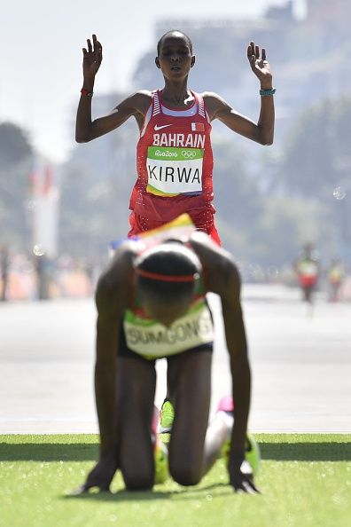 Bahrain's Eunice Jepkirui Kirwa celebrates her second place behind first placed…