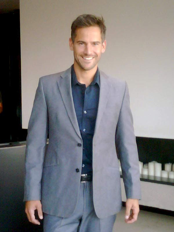 Janez wearing grey C'Squared suit, and navy shirt from Blue Collar ...