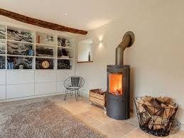 Image result for log burners in living room with brick wall