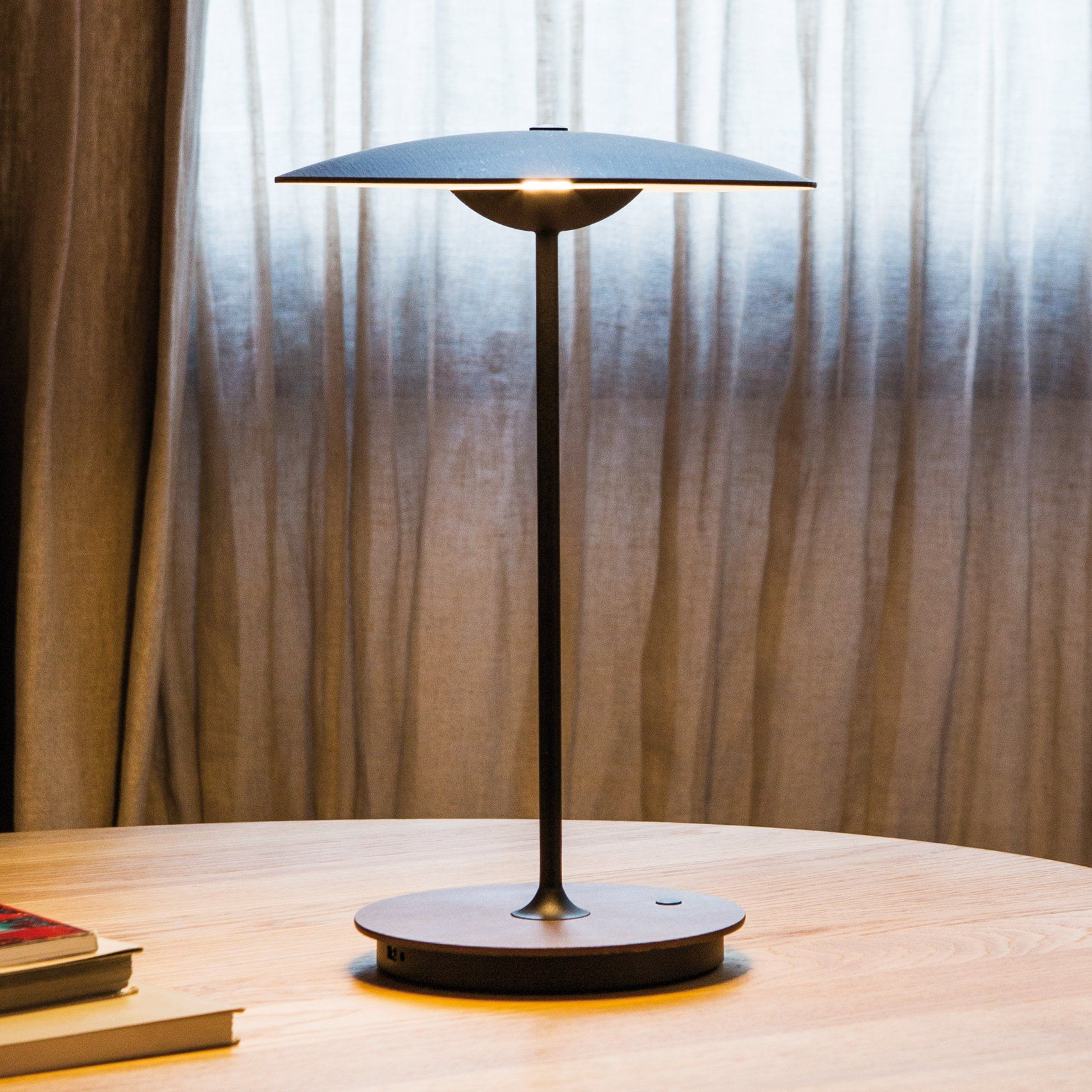 a barcelona portable brand and the house it that detached carried with be around has allows released battery pin to rechargeable marset lamp