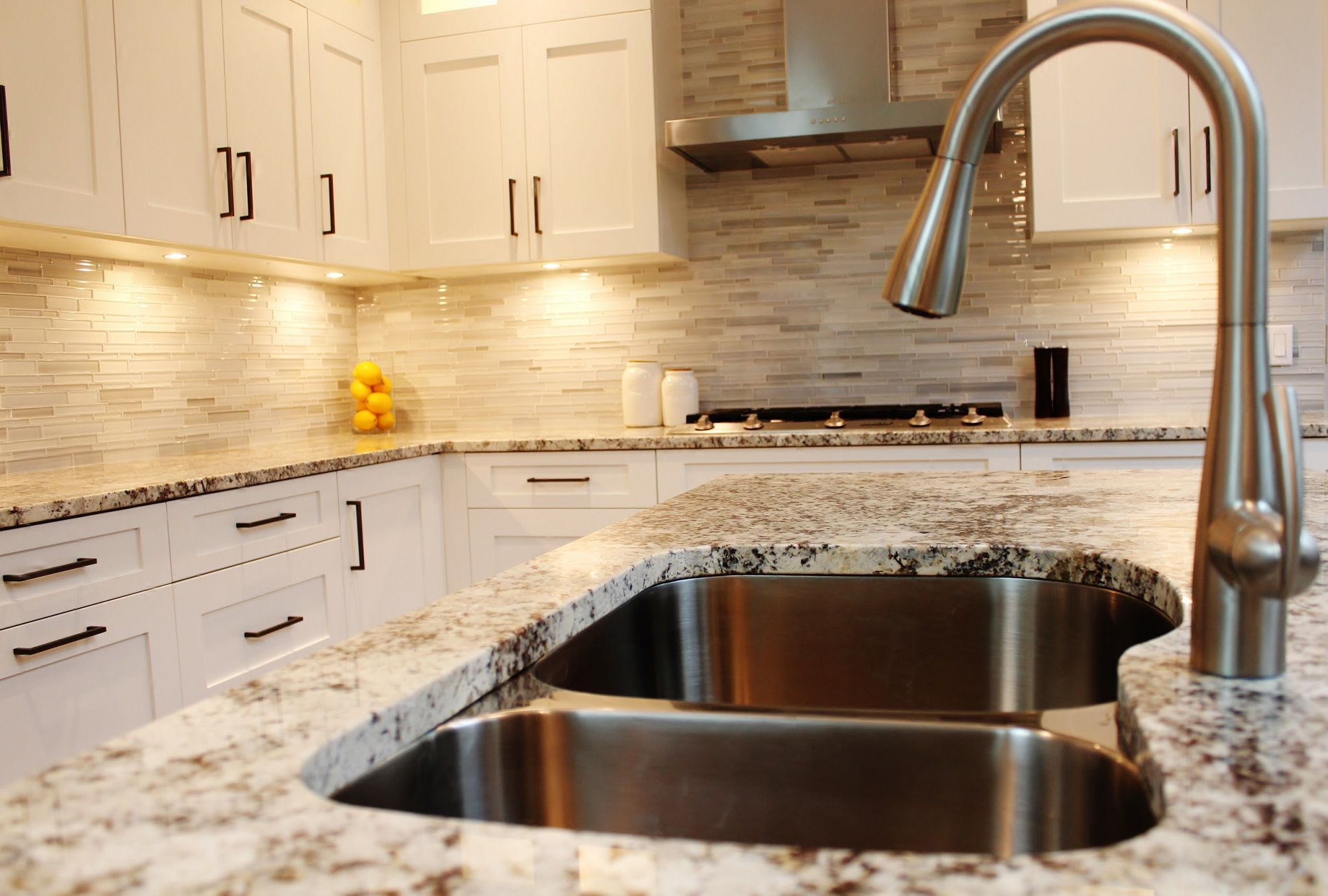 white cabinets with alaskan white granite