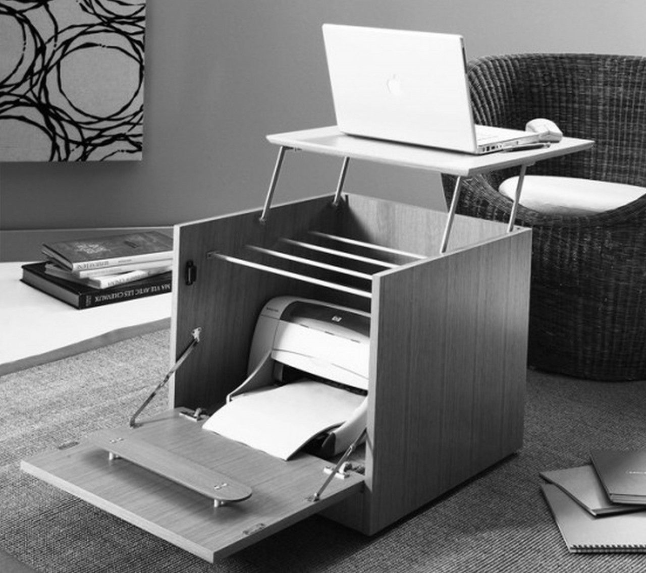 side table that doubles as a laptop / printer hideaway desk . very
