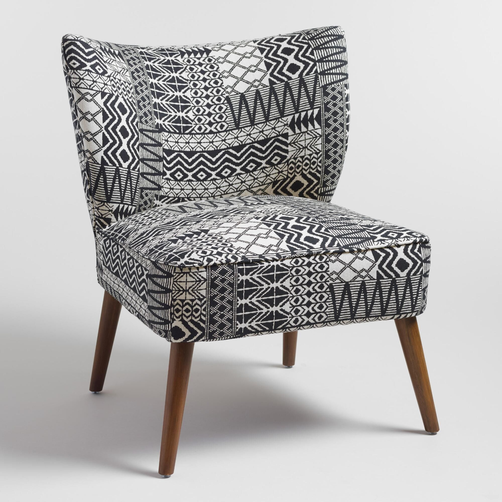 Our Plush Accent Chair Brings A Boho Vibe To Any E With Black And White Tribal Print Jacquard Upholstery Splayed Wood Legs Www Worldmarket