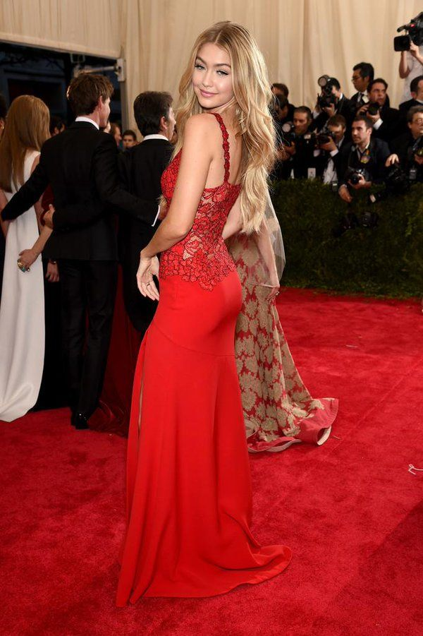 Gigi Hadid wore a pretty red @DVF custom gown at the #METGala. #METBall #ChinaLookingGlass
