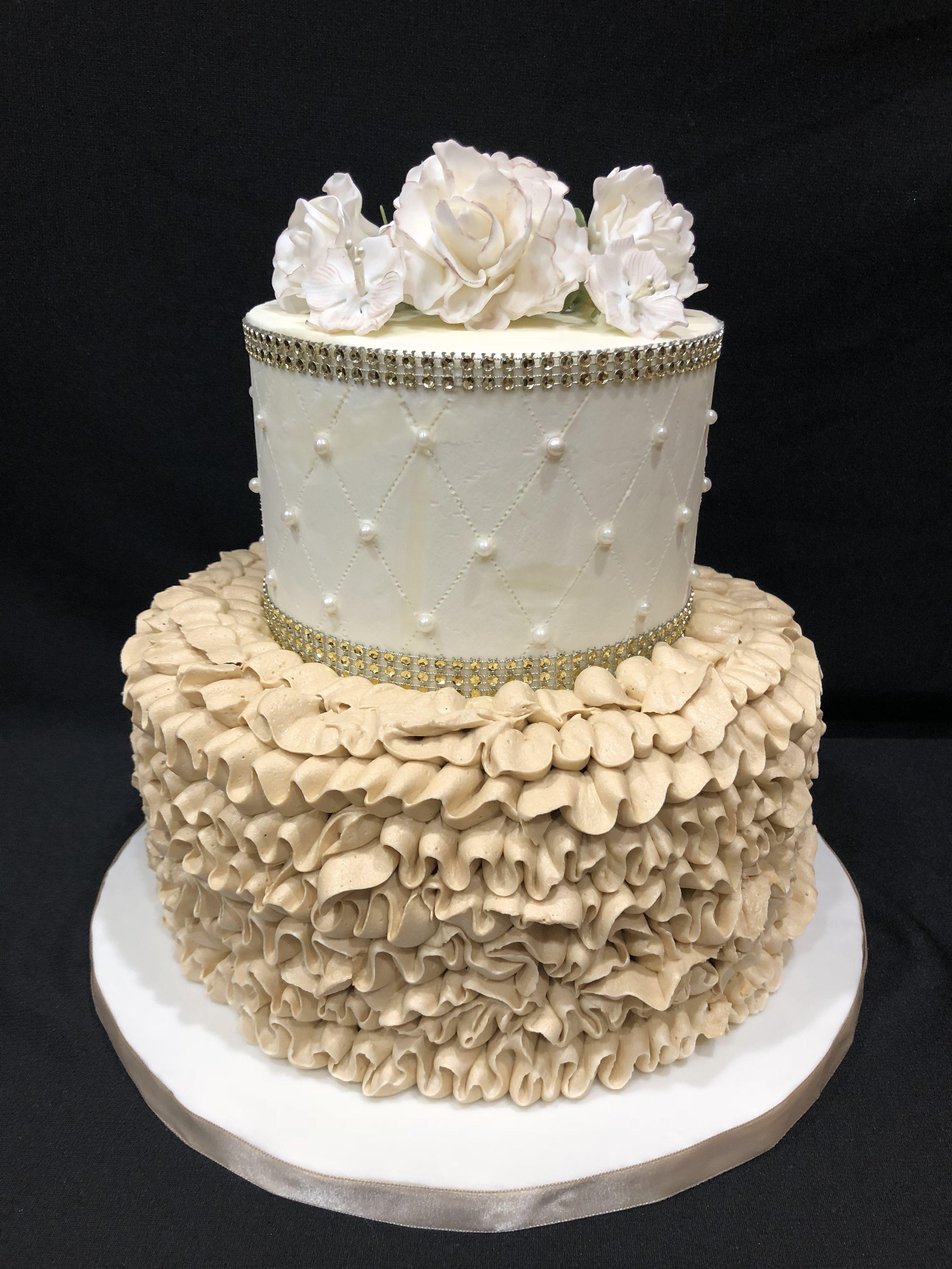 Elegant white and ivory cake ruffles and flowers
