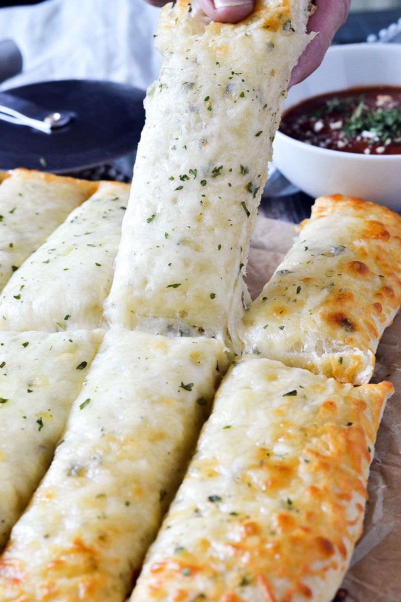 Cheesy Garlic Breadsticks Mother Thyme Recipe Garlic Breadsticks Cheesy Garlic Bread Cheesy Breadsticks