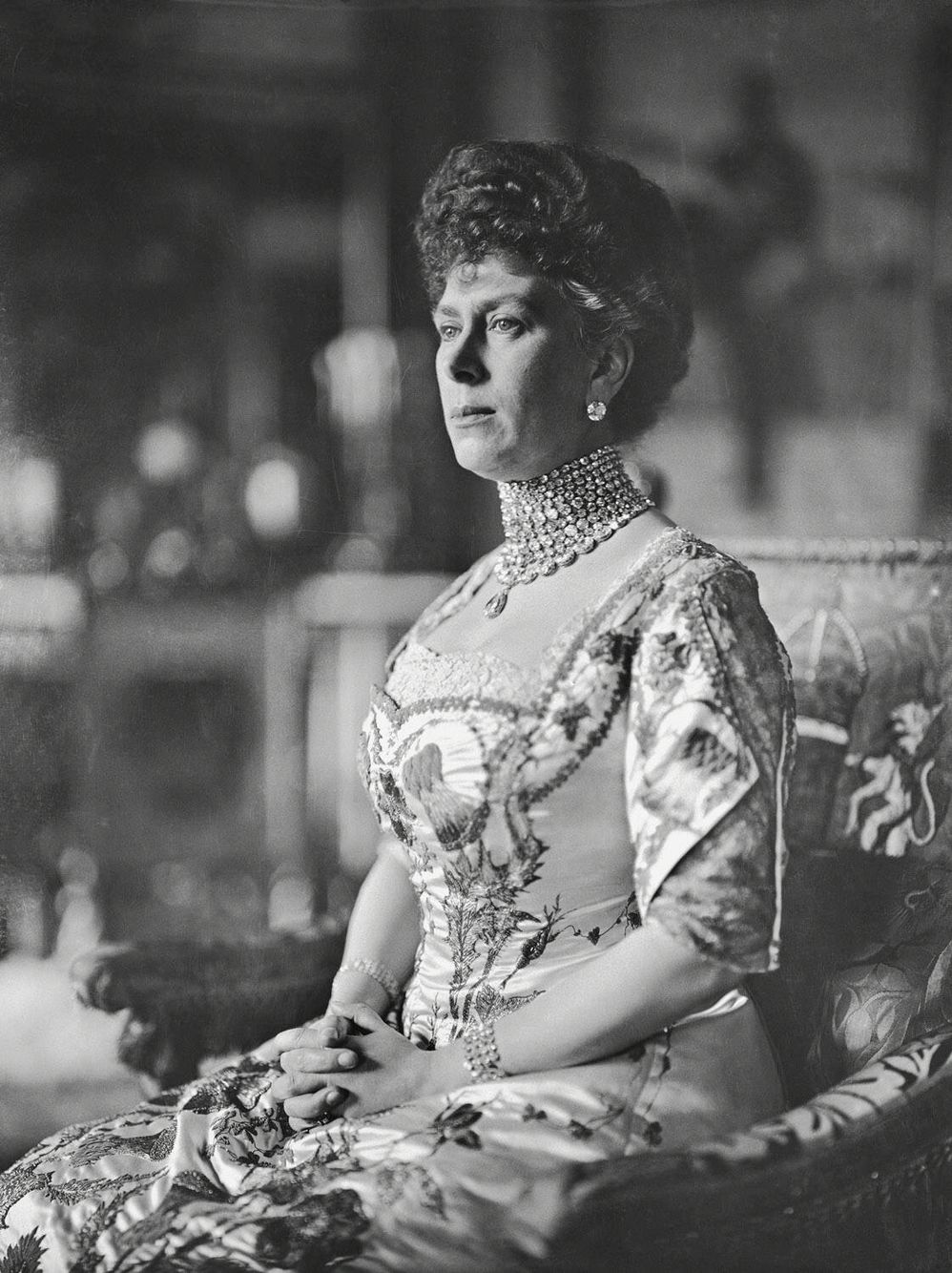 Queen Mary. A good close-up of Queen Mary's coronation gown. She is wearing no bodice ornaments so this photograph may have been taken some time after the event itself. With various adjustments this gown saw service at subsequent state occasions including the Delhi Durbar.