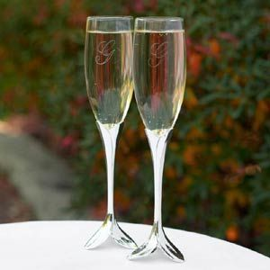 "Toasting Flutes - Flower Petal Flutes -  WeddingDepot.com - 030-20713P-NI Set of 2 flutes.  Silver-plated, petal-shaped stems and bases.  Measure 10.25"" tall.   Toasting glasses can be custom engraved"