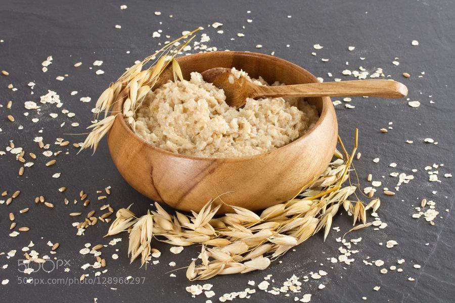 Oatmeal in a wooden bowl and ears of corn oat #daleholman #daleholmanmaine